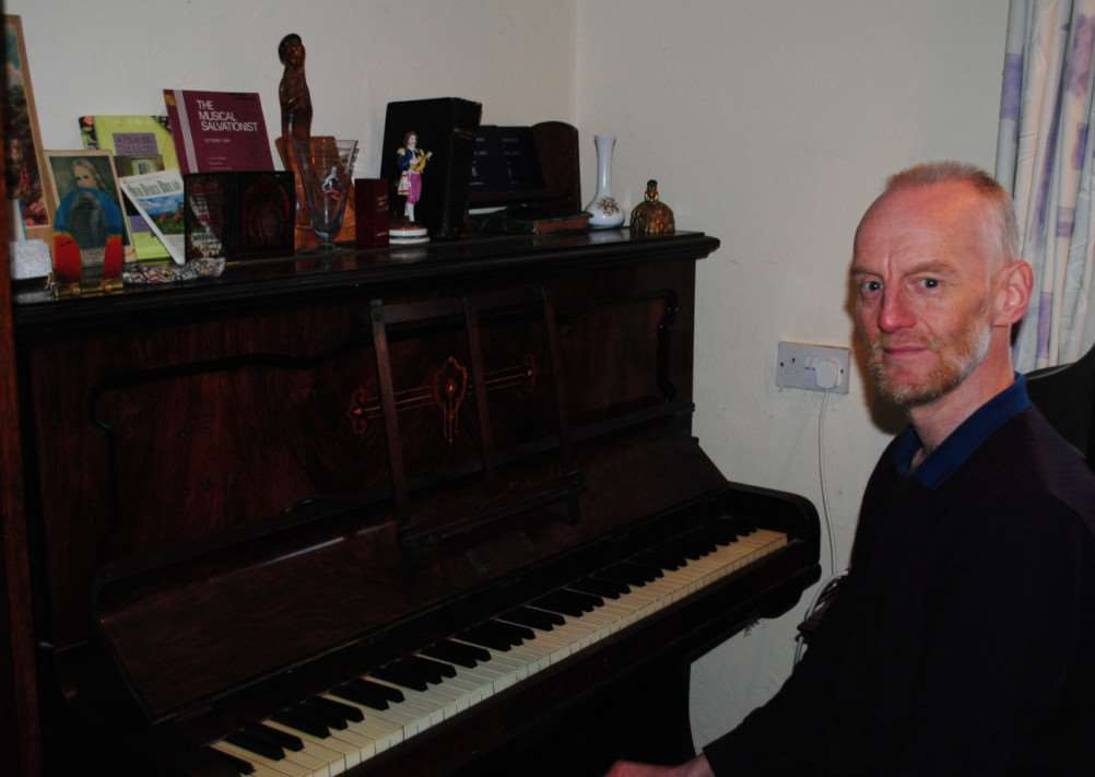 Stephen Hewerdine sat at his late mother Doris' piano.