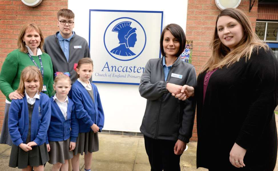 Ancaster Co-op supports Ancaster Primary School. Adults from left are deputy headteacher Claire Talbot, Jamie Talton, of the Co-op, Melissa Winter, of the Co-op, and Kirsty McGauley, chair of the PTFA. TRP-20-4-2017-214B