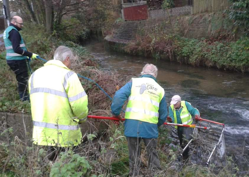 Members of Grantham Rivercare retrieve a trolley from the River Witham.