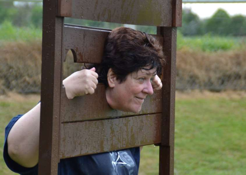 Barkstonbury: headteacher Sally Anne Caunter in the stocks