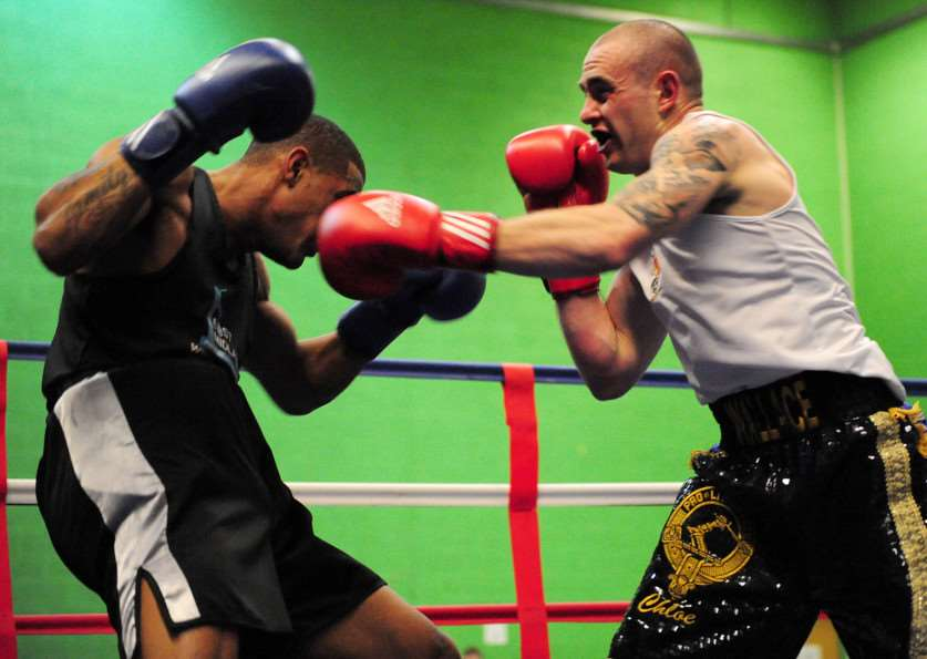 Grantham ABC's Nathan Wallace (right) rocks opponent Akim Douglas. Photo: Toby Roberts