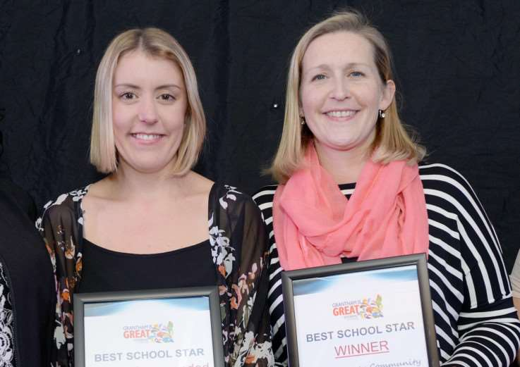 Huntingtower staff Lyndsey Dewhurst and Emma Harkins collect the Best School Star award.