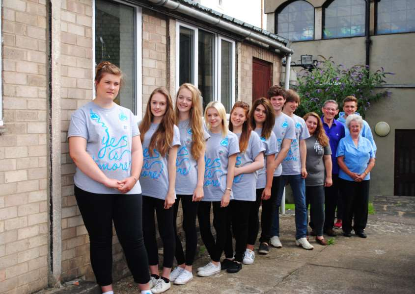 NCS teens with Grantham Passage's Mike Monaghan and Ruby Stuckey, when they prepared to clear out the storage building set to become the homeless outreach centre.