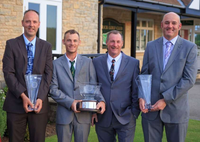 The Corbys and the Greens show off their spoils after they finished as top dogs in the Heathland Golf Classic.