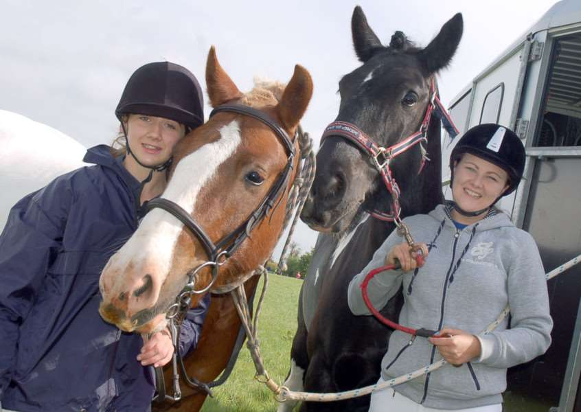 Amber Thorpe and her horse Homer get set to ride with friend Abbie Smith and Blade.