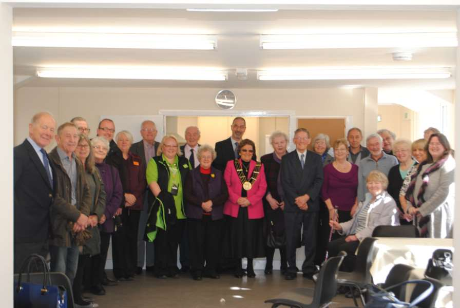 Donors and volunteers inside Grantham Passage's new centre.