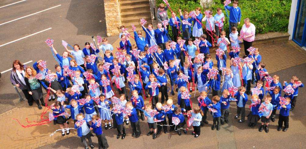 Children at Barkston and Syston Primary School with their Union Jack kites which they flew to celebrate the Queen's 90th birthday. Photo: M. Bailey.