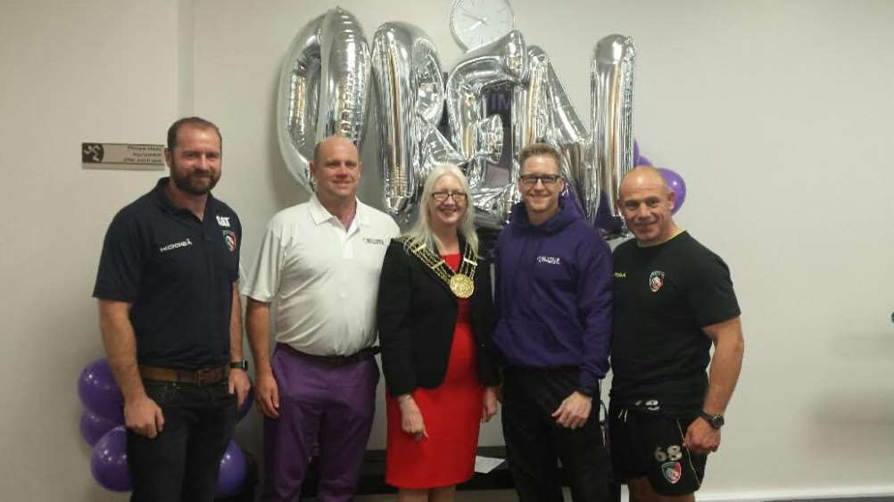 Geordan Murphy, left, and Richard Cockerill, right, of Leicester Tigers, help open Anytime Fitness in Westgate, Grantham.