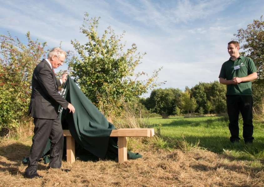 HRH unveils commemorative bench as Woodland Trust site manager, Ian Froggatt, looks on. Photo: Philip Formby.