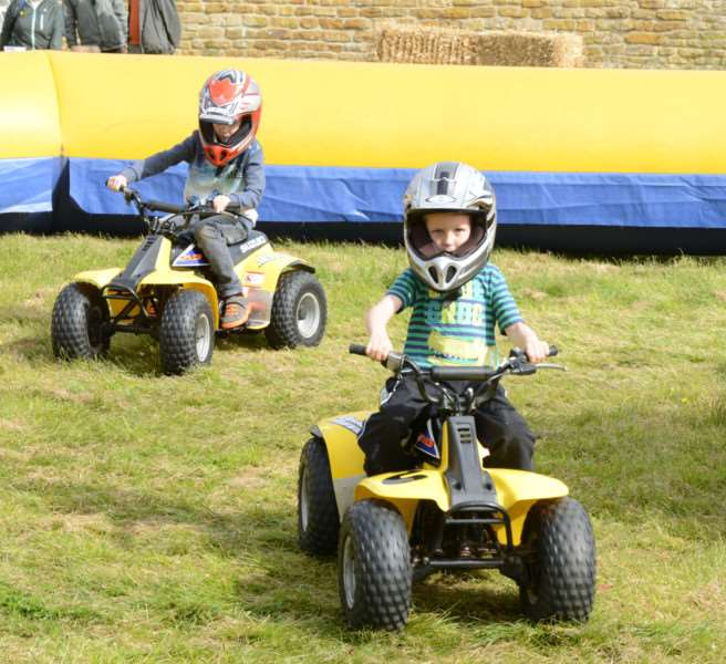 Aiden and Aaron Hill enjoy four-wheeled fun at Denton Street market.