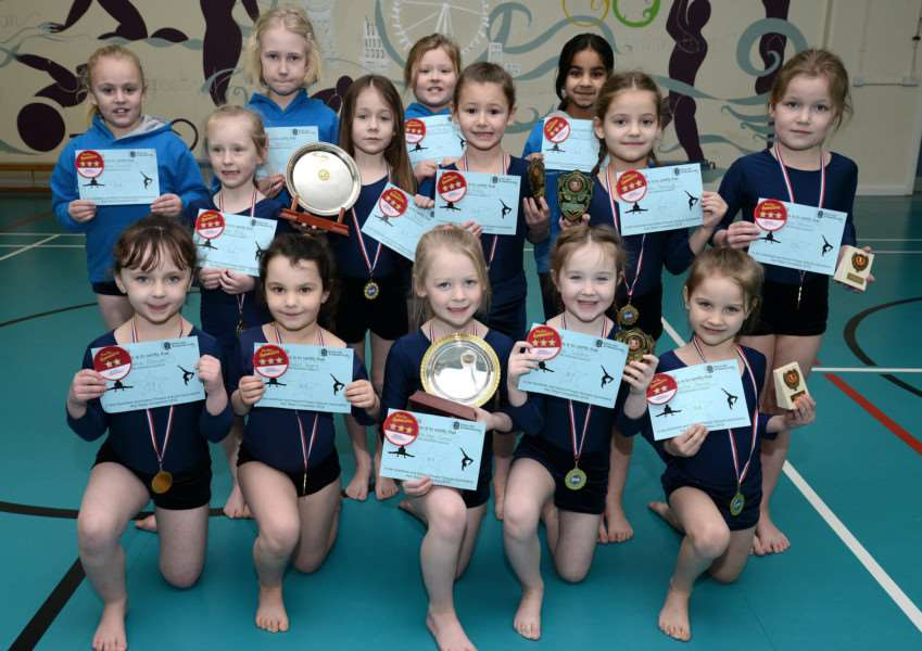 Belton Lane Primary School gymnasts show off their certificates. Photo: Toby Roberts