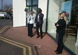 Staff at Duckworth's Land Rover watch the eclipse EMN-150320-111751001