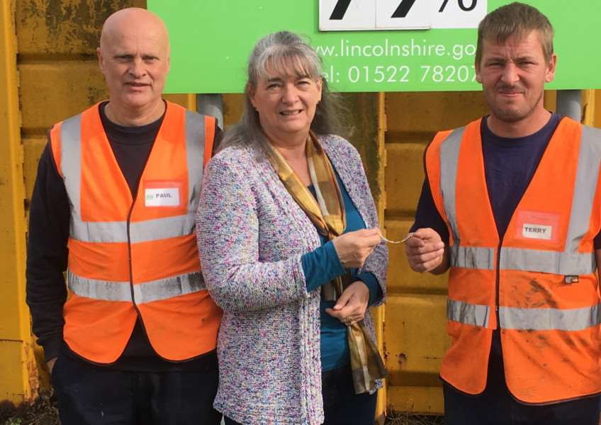 Kath Groom is reunited with her bracelet by workers at Grantham recycling centre.