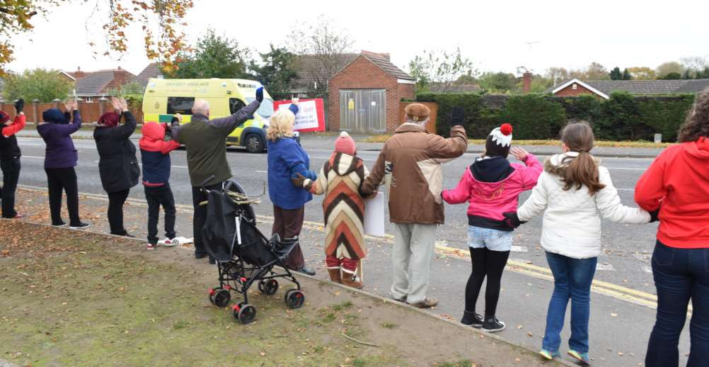 Protesters outside Grantham Hospital at the holding hands event on Sunday.
