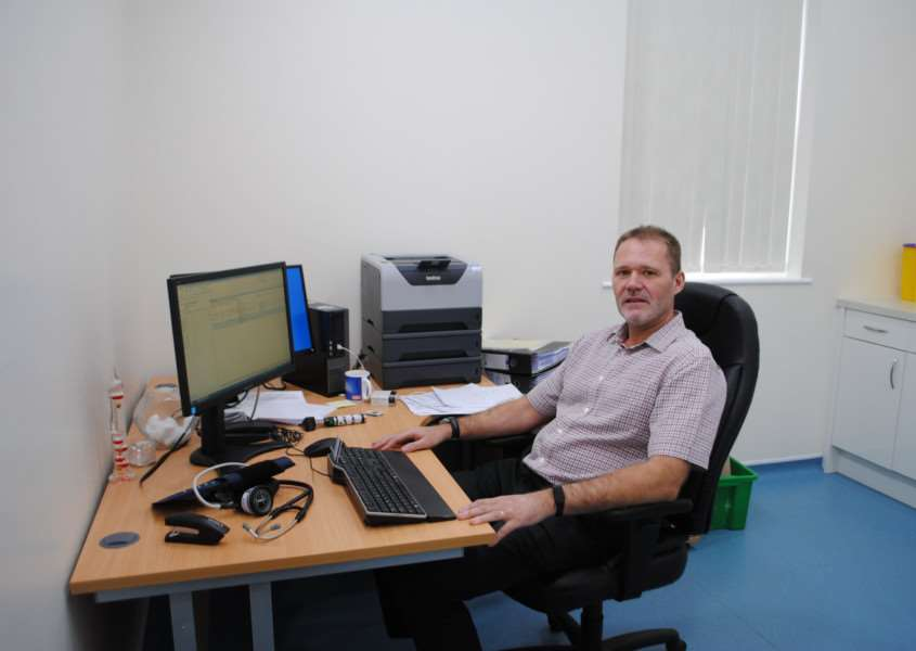 Dr David Baker, senior partner at Vine House Surgery, sat in his new consulting room, part of a �350,000 extension to the Grantham practice.