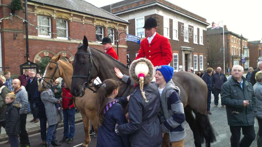The horses of the Belvoir Hunt get a lot of attention at the Boxing Day meeting on St Peter's Hill in Grantham.