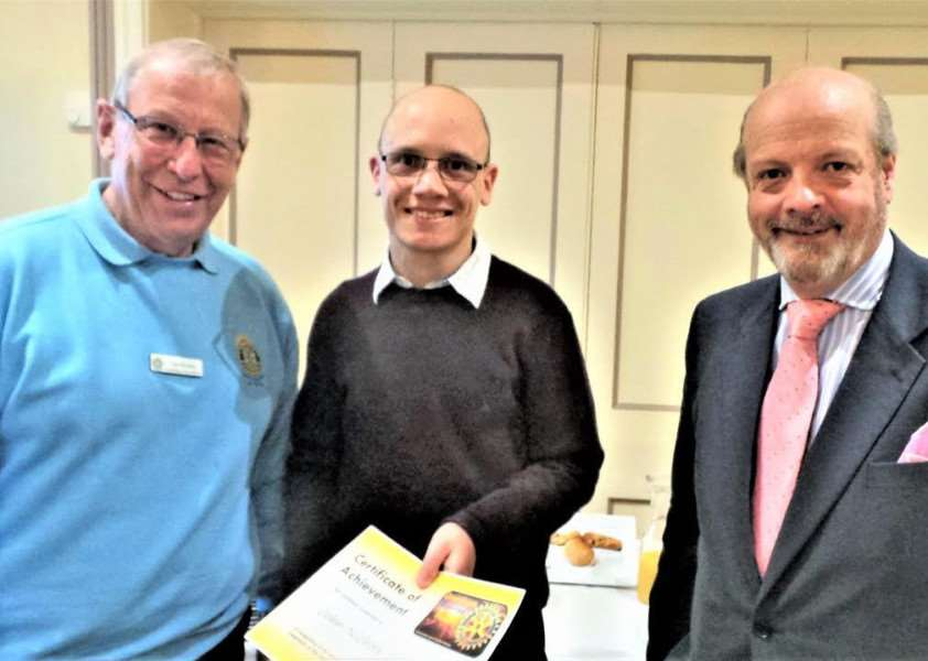 John Nichols is pictured (centre) with Rotary club president Ian Brodie, who presented the certificate of accomplishment to John, and Peter Townsend.