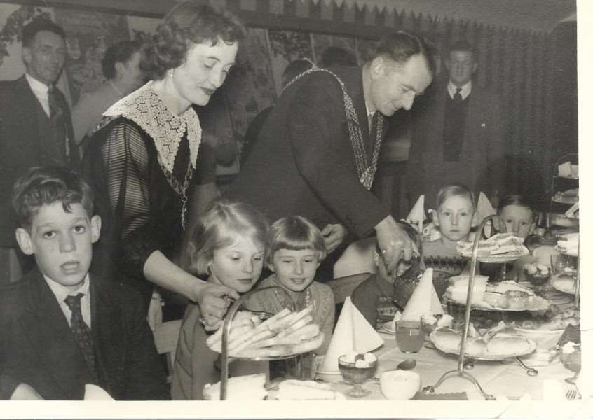 Mayor of Grantham Fred Foster and his wife Peggy at a children's party. Sat on the left is George Garrett, still a familiar face around town these days.