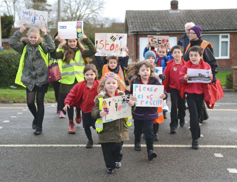 These youngsters want their journey to Kings Farm Day Nursery, which includes crossing the busy Main Road in Long Bennington, to be made safer with a zebra crossing. Photo: Toby Roberts.
