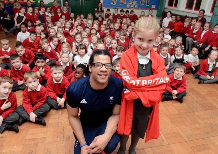 Paralympics athlete Sam Ruddock visits Harrowby Infants School and is pictured with pupil Aimee Green who is taking part in a 5km run. Photo: TRP-19-1-2017-075B (4)
