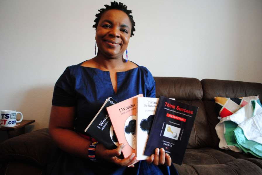 Debrah Mowlem with the books she has written.
