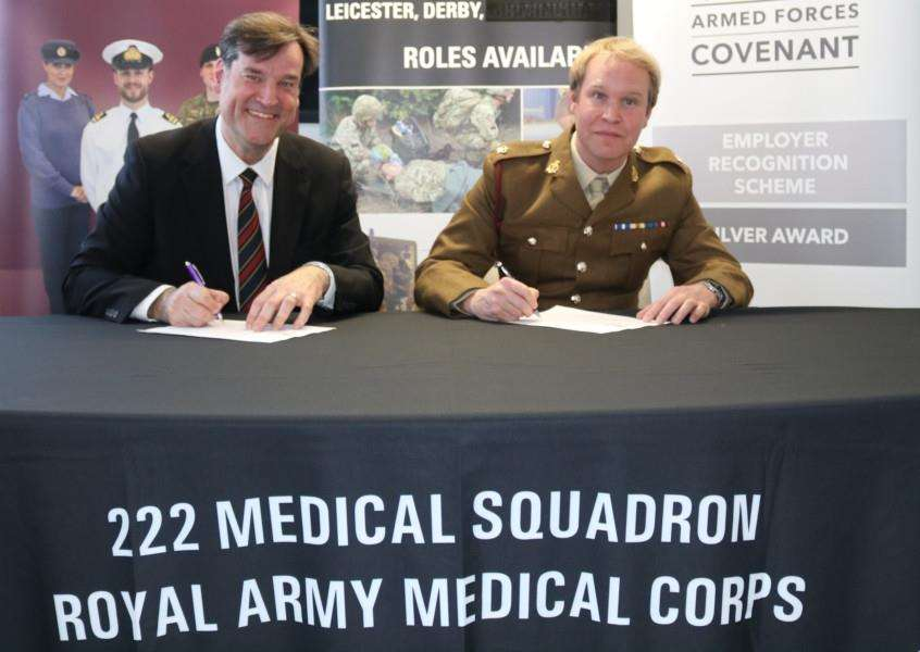 Dean Fathers, chairman of United Lincolnshire Hospitals NHS Trust, and Major Charles Dickens, of 2 Medical Regiment, Royal Army Medical Corps, sign the Armed Forces Covenant.