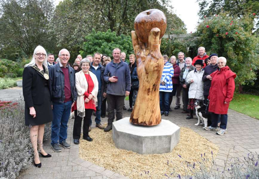 The restored Isaac's Apple sculpture following its unveiling in the sensory garden, Wyndham Park, Grantham.