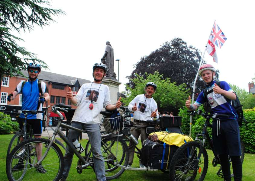 Four cyclists, Tom Fletcher, Adrian Danbury, Terry Jonas and Ryan Moore, celebrate the end of their fund-raising journey from Grantham to London and back.
