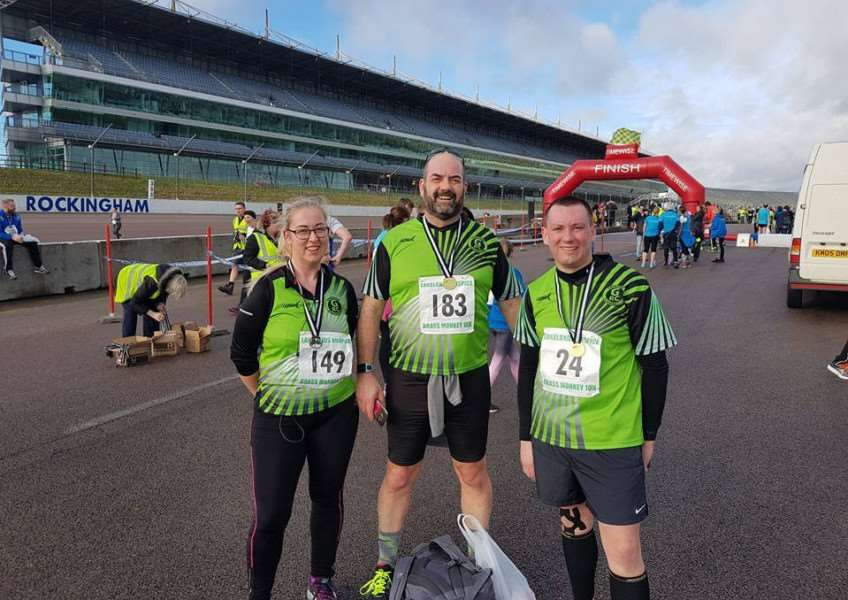 Grantham Running Club's Stuart Baty, Simon Hartley and Lucinda Gamble at Rockingham Speedway.