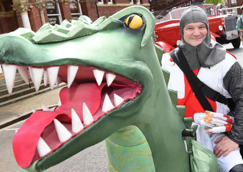 George and the Dragon arrive on St Peter' Hill green in Grantham for the St George's Day celebrations.