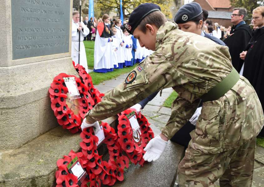 Laying wreaths at the war memorial at St Wulfram's Church in Grantham on Remembrance Day. 626A+(48) EMN-151116-113135001