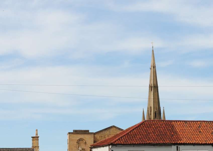 A view of St Wulfram's Church spire from the town centre.