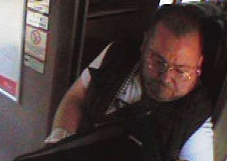 British Transport Police want to identify this man in connection with the theft of a case from a train at Grantham.