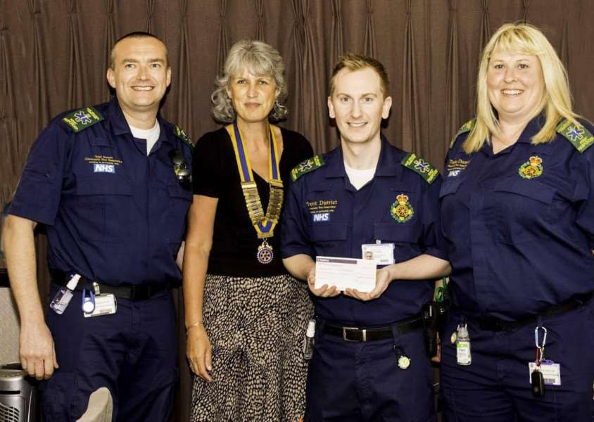 Chris, Oliver and Alison from the Trent Community Responders receive a cheque from Rotary Club of the Vale of Belvoir president Jennie Henley.