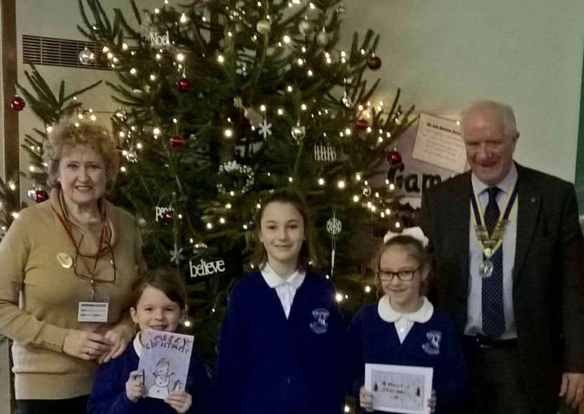 President Stephen Short and rotarian Glenys Robertson with winners Isla, Roxy and Sofia