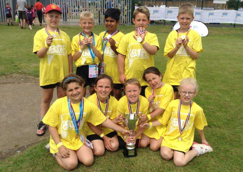 Isaac Newton's golfing champs show off their silverware and medals.