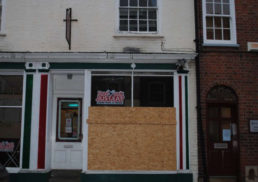 Monalisa Pizza on Castlegate have had to board up the damaged window.