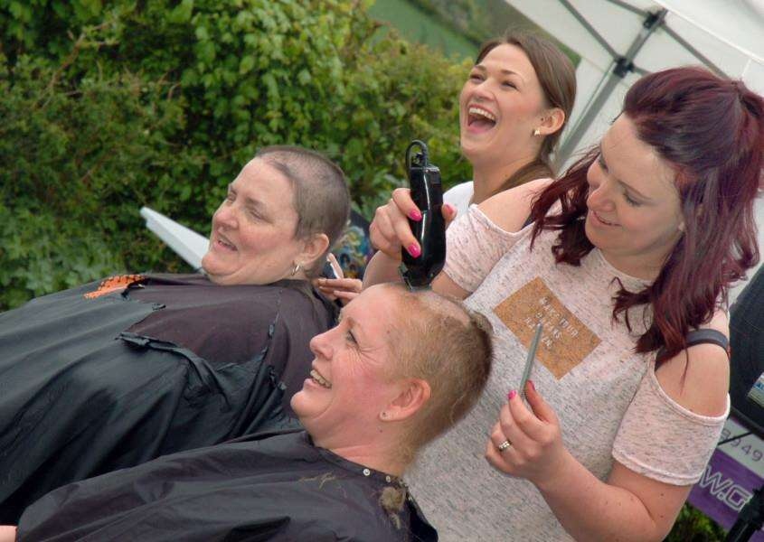 Hairdressers Georgina Steward and Nicola Croft go to work on Hazel Bonshor and Sally-Ann Watson 'PHOTO: Tim Williams EMN-160516-163653001