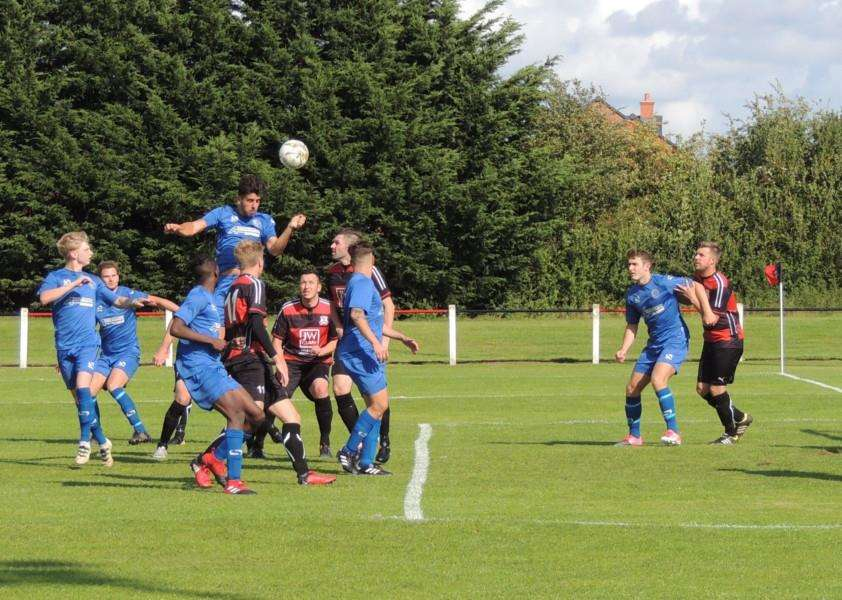 Harrowby United's Joel Carta heads just wide from a corner at Raunds on Saturday.